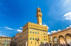 Palazzo Vecchio palace with bell tower with clock and Loggia dei Lanzi on Piazza della Signoria square in historical centre of Flo stock photo
