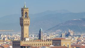 Palazzo Vecchio timelapse on piazza della Signora in the morning as seen from Piazzale Michelangelo. Florence, Italy. Mountains on background. Aerial top view stock video