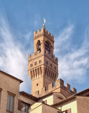 Palazzo Vecchio Tower against blue sky Stock Photography