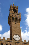 Palazzo vecchio tower in Florence. The old tower with clock in piazza signoria Stock Images