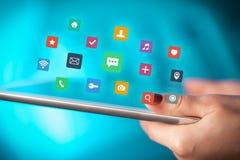 Palce dotyka pastylkę z apps Obrazy Stock