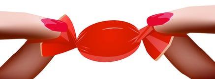 Palce trzyma cukierku A kobiety ` s rękę trzymają czerwonego cukierek Obraz Stock