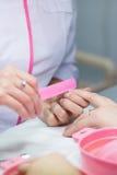 Palcowa gwoździa manicure'u opieka Zdjęcia Royalty Free