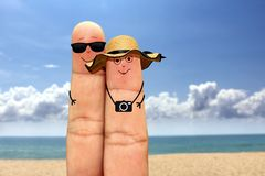 Palcowa pary twarz na wakacje przy plażą Zdjęcie Royalty Free
