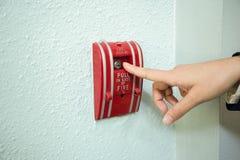 Palcowy ciągnienie pożarniczego alarma narzędzie Obrazy Royalty Free