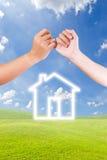 palcowy ręki domu ikony zazębianie Fotografia Stock