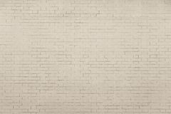 The pale beige textured surface of a brick wall. For empty and pure backgrounds Stock Photos