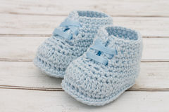 Pale Blue Baby Booties on wood background Royalty Free Stock Photography