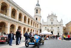 A pale blue Bugatti T13 Brescia takes part to the 1000 Miglia classic car race. LORETO (AN), ITALY - MAY 16: A pale blue Bugatti T13 Brescia takes part to the Stock Image