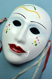 Pale blue ceramic mask.  Close up. Stock Photos