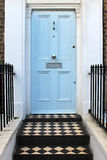 Pale blue door Stock Photography