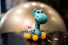 Pale-blue giraffe toy. A windup toy, azure giraffe Royalty Free Stock Photos
