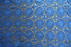 Pale blue lacy fabric on wood. From above Royalty Free Stock Photo