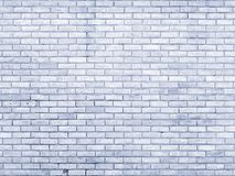 Pale blue old brick wall with repeating pattern. Background Royalty Free Stock Photos
