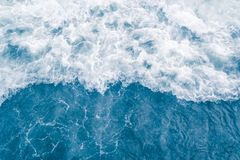 Pale blue sea wave during high summer tide, abstract ocean background.  royalty free stock photo