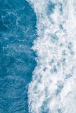 Pale blue sea wave during high summer tide, abstract ocean background.  royalty free stock image