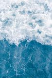 Pale blue sea wave during high summer tide, abstract ocean background.  royalty free stock images