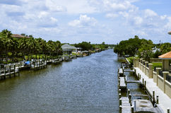 Pale blue sky over inter-coastal with docks and houses Royalty Free Stock Photos
