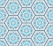 Pale blue snowflakes in hexagons seamless pattern. Vector. Pale blue snowflakes in hexagons seamless pattern. Winter holidays texture. Vector background Royalty Free Stock Photo