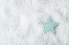 Pale Blue Star on White Snow from Above Stock Photography