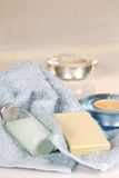 Pale blue towels with soap, shampoo and candles Stock Images