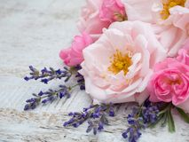 Pale and bright roses and provence lavender bouquet. On the wooden rustic background Royalty Free Stock Image