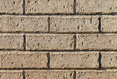 Pale brown brick wall background. Closeup of pale brown brick wall stock photo