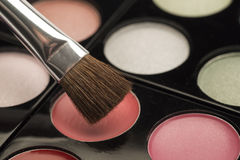 Pale eye make up with a brush Royalty Free Stock Images