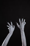 Pale ghost hands with sharp black nails, body art Royalty Free Stock Image
