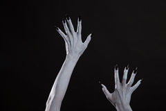 Pale ghost or witch hands with sharp black nails. Halloween theme stock image