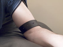 Pale Male Arm with Leather Belt stock photos