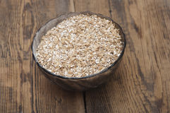 Pale malt barley in a glass bowl, an ingredient for beer. Royalty Free Stock Image