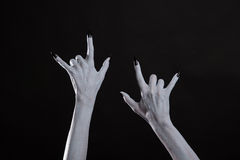 Pale monster hands showing heavy metal symbol Stock Image