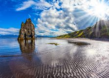 Pale northern sun. The Basalt rock - Mammot Hvitsercur during an ocean outflow. Concept of northern extreme tourism. Pale northern sun of Iceland at sunset Stock Image