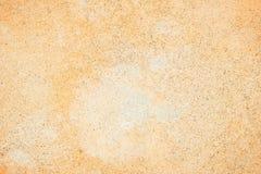 Pale orange concrete wall texture background Stock Photos