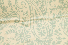 Pale Paisley Wrinkled Textured Background. Pale teal and white grunge textured paisley background Stock Photo