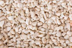 Pale pebbles background, simplicity, daylight, stones on macro. High resolution photo stock photography