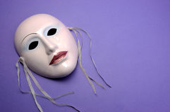 Pale pink ceramic mask with copy space Royalty Free Stock Photography