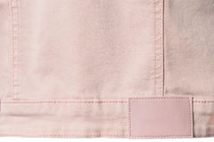 Pale pink denim with leather label for background Royalty Free Stock Photos