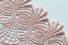 Pale pink flower lace material texture macro shot Stock Image