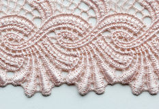 Pale pink flower lace material texture macro shot Royalty Free Stock Images