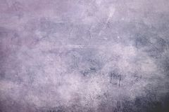 Pale purple grungy canvas background or texture with dark vignett stock image