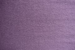 Pale pink handmade knitted fabric. From above royalty free stock photo