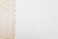 Pale pink openwork lace on left border on white background royalty free stock images