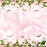 Pale pink roses on the background of pink satin. Pale pink roses on the background of light pink satin Stock Image