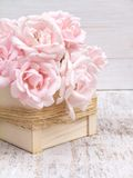 Pale pink roses bouquet in the wooden box Stock Image