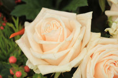 Pale pink roses. In a floral arrangement at a wedding Stock Photo