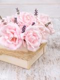 Pale pink roses and lavender bouquet in the wooden box Royalty Free Stock Photos