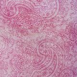 Paisley patterned background in shades red and pink. A pale pink shabby background covered in fancy red elaborate paisley shapes Royalty Free Stock Photo