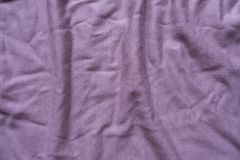 Pale pink viscose fabric with folds. From above Stock Photos